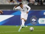 Kylian Mbappe shoots at goal for France on June 8, 2021