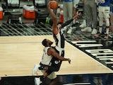 Dallas Mavericks forward Tim Hardaway Jr. fouls Los Angeles Clippers guard Paul George on June 6, 2021