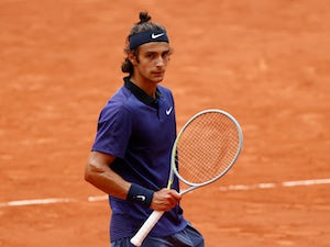 French Open roundup: Djokovic survives scare, Nadal eases to victory