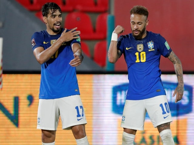 Brazil's Lucas Paqueta celebrates scoring their second goal with Neymar on June 9, 2021