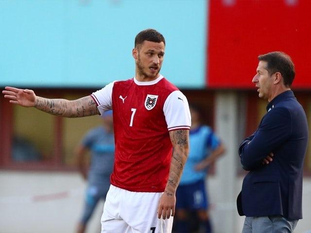 Austria manager Franco Foda and Marko Arnautovic on June 6, 2021