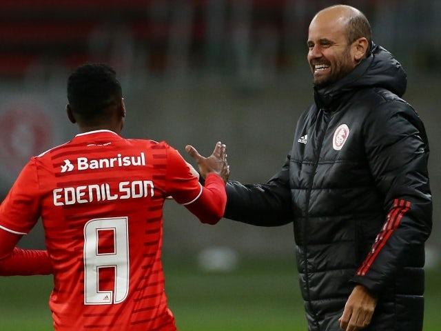 Internacional's Edenilson celebrates scoring their first goal with coach Miguel Angel Ramirez on May 31, 2021