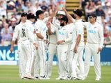 New Zealand's Trent Boult celebrates with teammates after taking the wicket of England's James Anderson on June 11, 2021