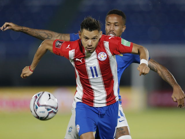 Paraguay's Angel Romero in action with Brazil's Eder Militao on June 9, 2021