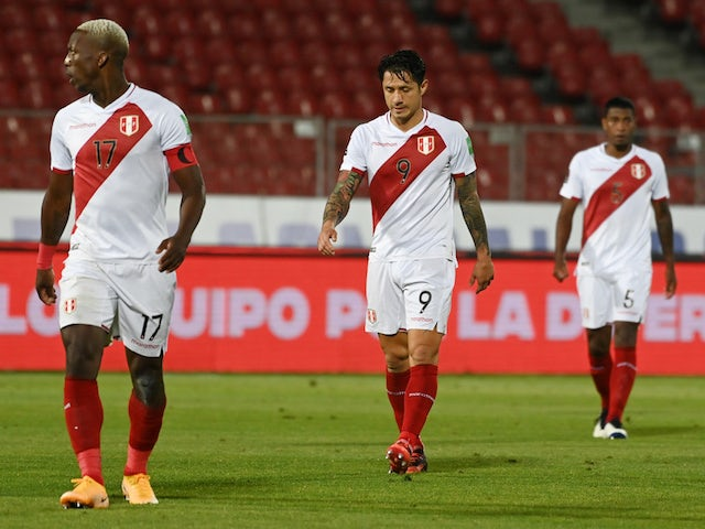 Peru's Gianluca Lapadula and teammates look dejected after the match on November 14, 2020