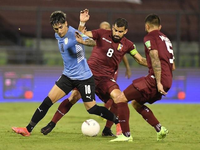 Uruguay's Facundo Torres in action with Venezuela's Tomas Rincon and Junior Moreno on June 8, 2021