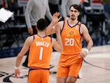 Phoenix Suns forward Dario Saric reacts with guard Devin Booker against the Denver Nuggets on June 12, 2021