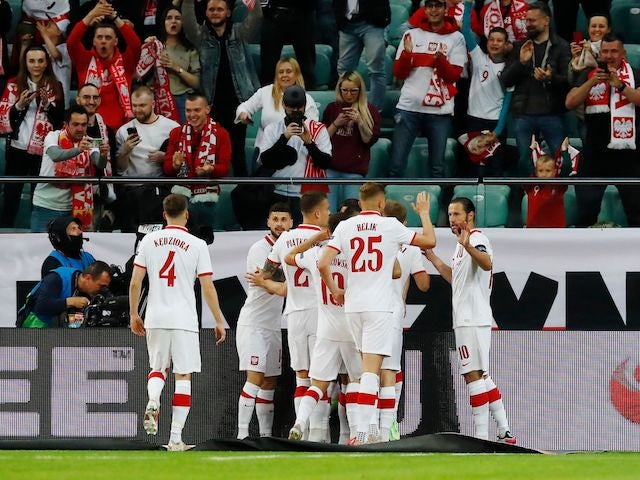 Poland's Jakub Swierczok celebrates scoring their first goal with teammates on June 1, 2021