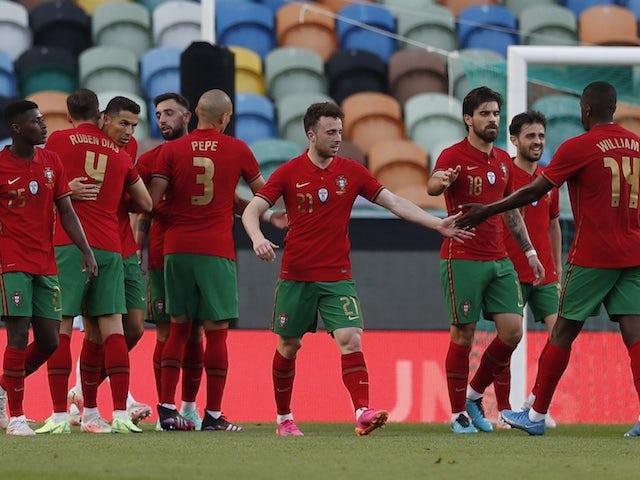 Portugal's Cristiano Ronaldo celebrates scoring their second goal with Ruben Dias, Bruno Fernandes, Pepe and teammates on June 9, 2021