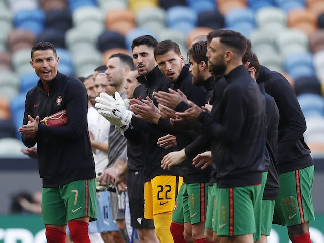 Portugal's Cristiano Ronaldo with teammates as they line up before the match on June 9, 2021