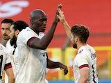 Belgium's Romelu Lukaku celebrates scoring their first goal with Dries Mertens on June 6, 2021