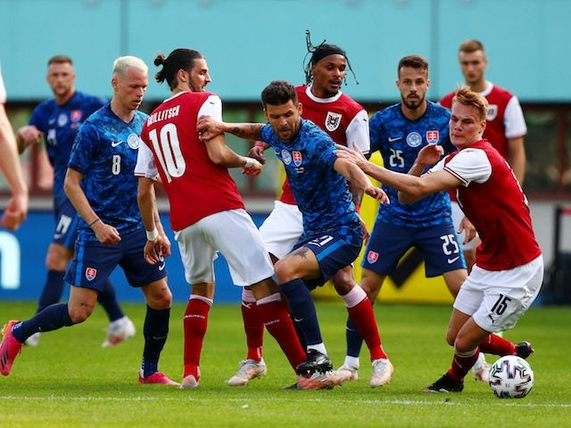 Slovakia's Michal Duris in action with Austria's Philipp Lienhart on June 6, 2021