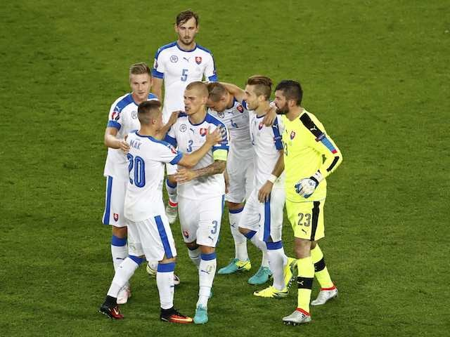Slovakia players celebrate scoring against England at Euro 2016