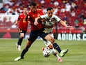Portugal's Pedro Goncalves in action with Spain's Rodri on June 4, 2021