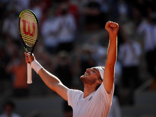 Greece's Stefanos Tsitsipas celebrates winning his semi final match against Germany's Alexander Zverev at the French Open on June 11, 2021