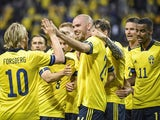 Sweden's Marcus Danielson celebrates scoring their second goal with teammates on June 5, 2021