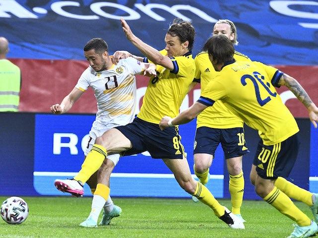 Armenia's Vahan Bichakhchyan in action with Sweden's Albin Ekdal on June 5, 2021
