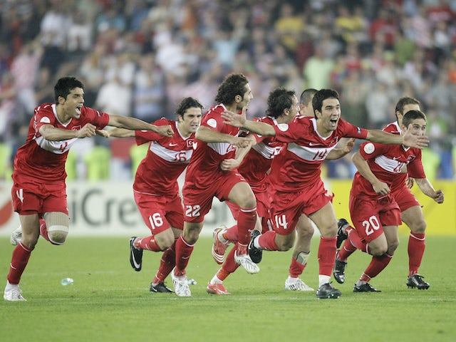 Turkey's players celebrate after their Euro 2008 quarter-final soccer match penalty shoot-out victory over Croatia at the Ernst Happel Stadium in Vienna, June 20, 2008