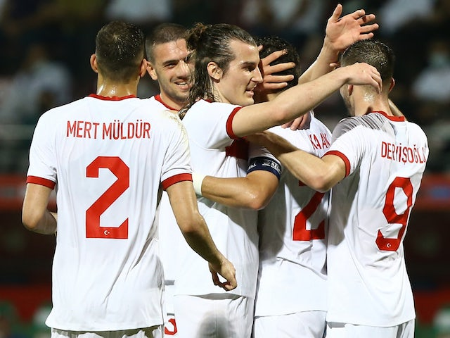 Turkey's Kaan Ayhan celebrates scoring their second goal with teammates on May 27, 2021