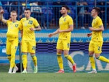 Ukraine's Oleksandr Zinchenko celebrates scoring their second goal with teammates on June 7, 2021