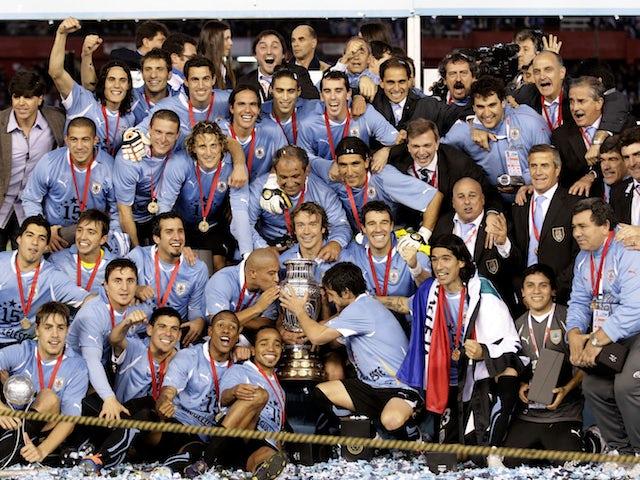 Uruguay players celebrate winning the 2011 Copa America final