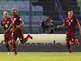 Venezuela's Josef Martínez celebrates scoring their first goal with Romulo Otero and Jefferson Savarino later disallowed after a VAR review on June 8, 2021