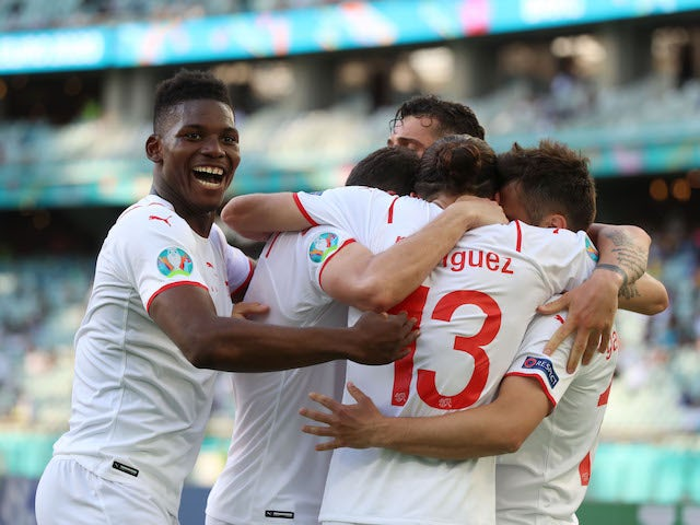 Switzerland's Breel Embolo celebrates after Mario Gavranovic scored a goal that was later disallowed by VAR for offside on June 12, 2021