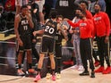 Atlanta Hawks forward John Collins and guard Trae Young hug after a victory against the Philadelphia 76ers on June 15, 2021