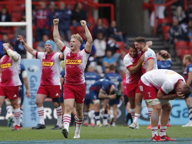 Harlequins' Louis Lynagh celebrates with teammates after the match with Bristol Bears on June 19, 2021