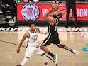 Brooklyn Nets guard James Harden shoots an off balanced shot over Milwaukee Bucks forward Giannis Antetokounmpo on June 20, 2021