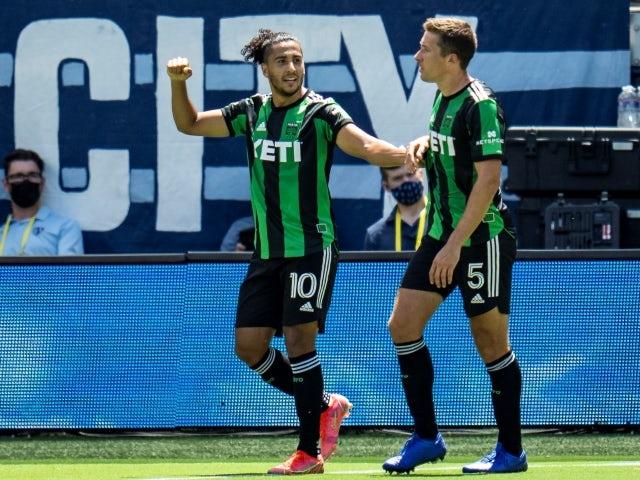 Austin FC forward Cecilio Dominguez celebrates with defender Matt Besler after scoring a goal on June 12, 2021