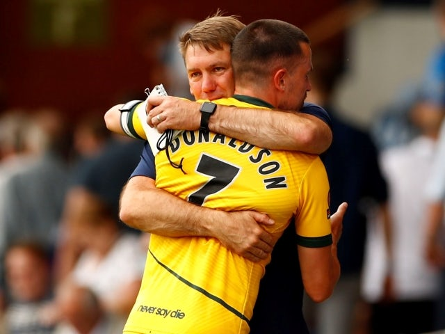 Hartlepool United's Ryan Donaldson and manager Dave Challinor celebrate after the game on June 13, 2021