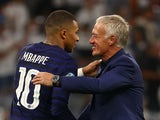 France coach Didier Deschamps celebrates with Kylian Mbappe after the match on June 15, 2021