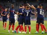 France's players celebrate after Germany's Mats Hummels scores an own goal at Euro 2020 on June 15, 2021