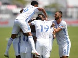 FC Cincinnati players celebrate around defender Gustavo Vallecilla after scoring on May 22, 2021