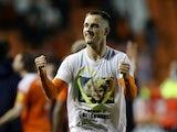 Jerry Yates celebrates earning promotion with Blackpool on May 21, 2021