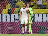 Germany's Mats Hummels is consoled by teammate Manuel Neuer after scoring an own goal on June 15, 2021