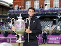 Italy's Matteo Berrettini poses as he celebrates winning the final match against Britain's Cameron Norrie at Queen's Club on June 20, 2021