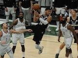 Milwaukee Bucks forwardMilwaukee Bucks' Giannis Antetokounmpo kicks it back out against Brooklyn Nets forward Jeff Green and guard James Harden on June 18, 2021