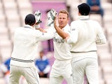 New Zealand's Neil Wagner celebrates with teammates after taking the wicket of India's Ajinkya Rahane on June 20, 2021