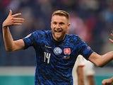Milan Skriniar celebrates scoring for Slovakia against Poland at Euro 2020 on June 14, 2021