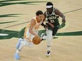 Atlanta Hawks guard Trae Young drives to the basket against Milwaukee Bucks guard Jrue Holiday on June 24, 2021