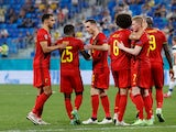 Belgium players celebrate an own goal scored by Finland's Lukas Hradecky at Euro 2020 on June 21, 2021