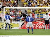 Ronaldinho scores for Brazil over England's David Seaman at the 2002 World Cup on June 21, 2002