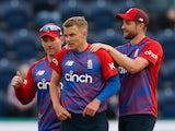England's Sam Curran celebrates with teammates after taking the wicket of Sri Lanka's Dasun Shanaka on June 23, 2021