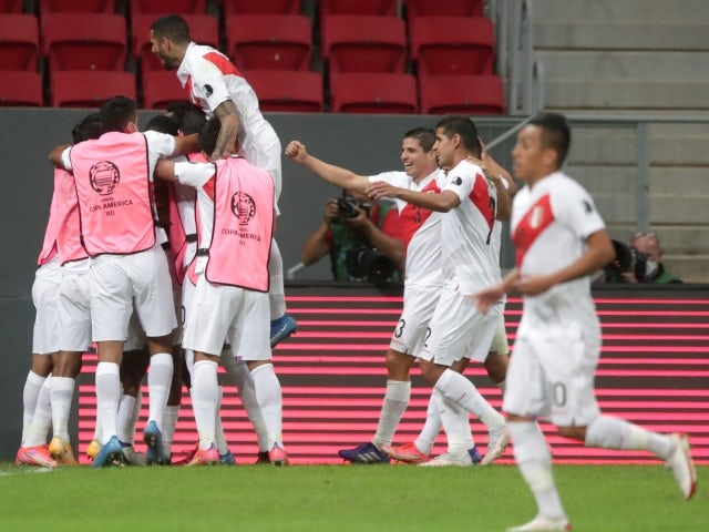 Peru's Andre Carrillo celebrates scoring their first goal with teammates on June 27, 2021