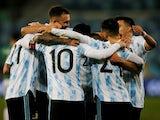 Argentina teammates celebrate scoring their third goal on June 29, 2021