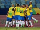 Brazil's Eder Militao celebrates scoring their first goal with teammates on June 27, 2021