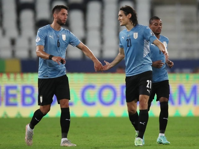 Uruguay's Edison Cavani celebrates scoring their first goal with Rodrigo Bentancur on June 29, 2021