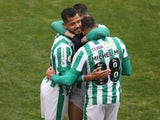 Juventude's Elton celebrates with teammates after the match on June 27, 2021
